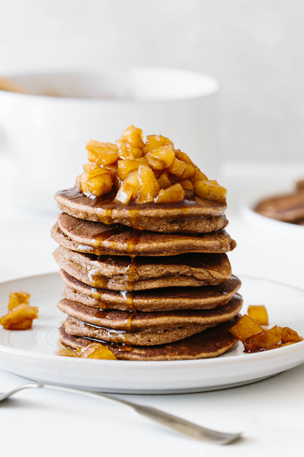 Stack of paleo pancakes with maple apple cinnamon topping.