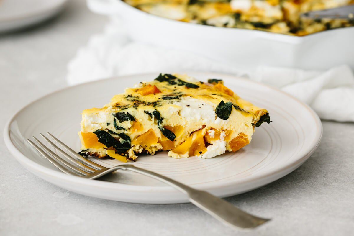 A single slice of butternut squash frittata on a plate.