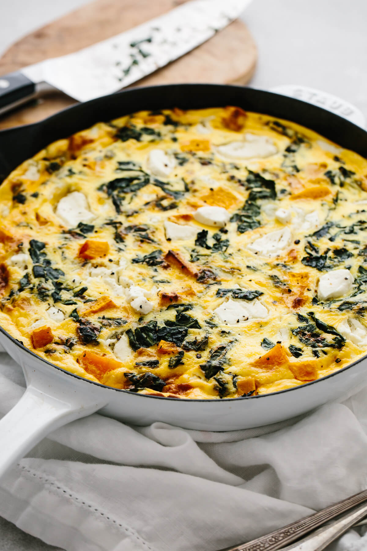 Butternut squash frittata served on a table.