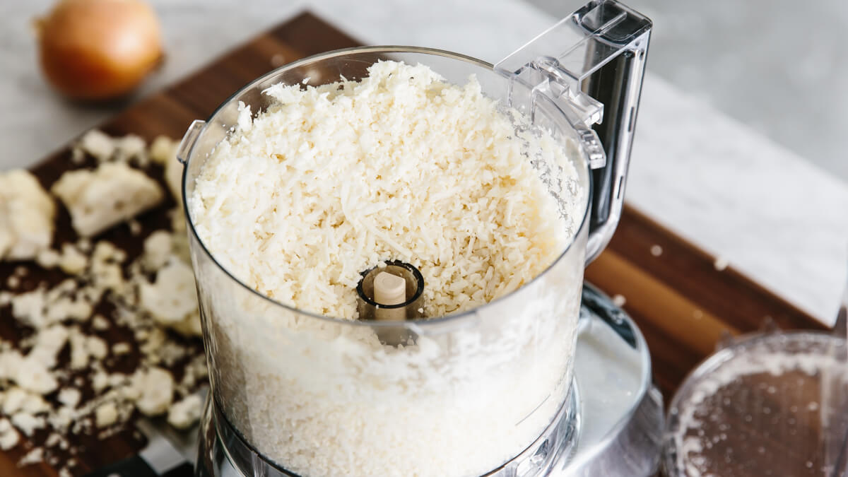 Cauliflower rice being made in a food processor.