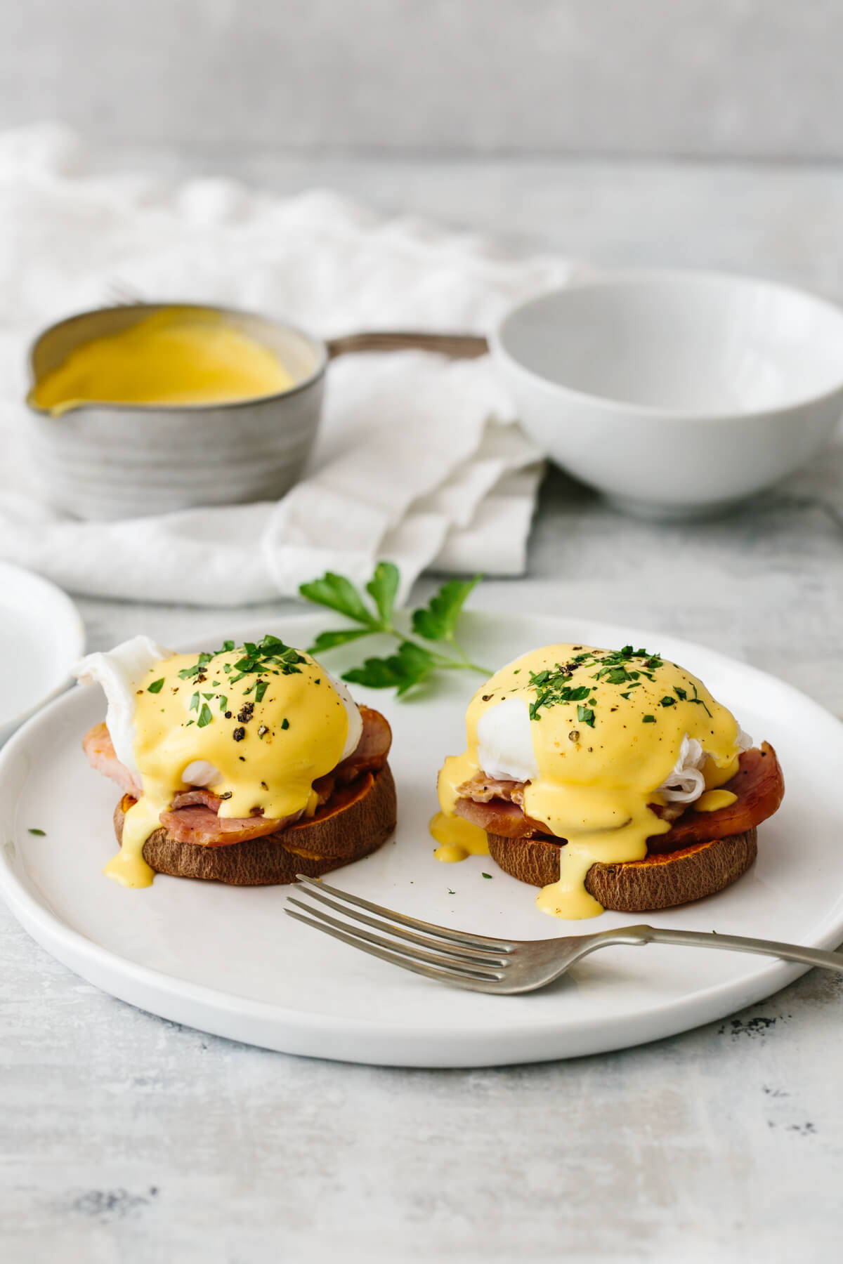 Two healthy eggs benedict on a plate.
