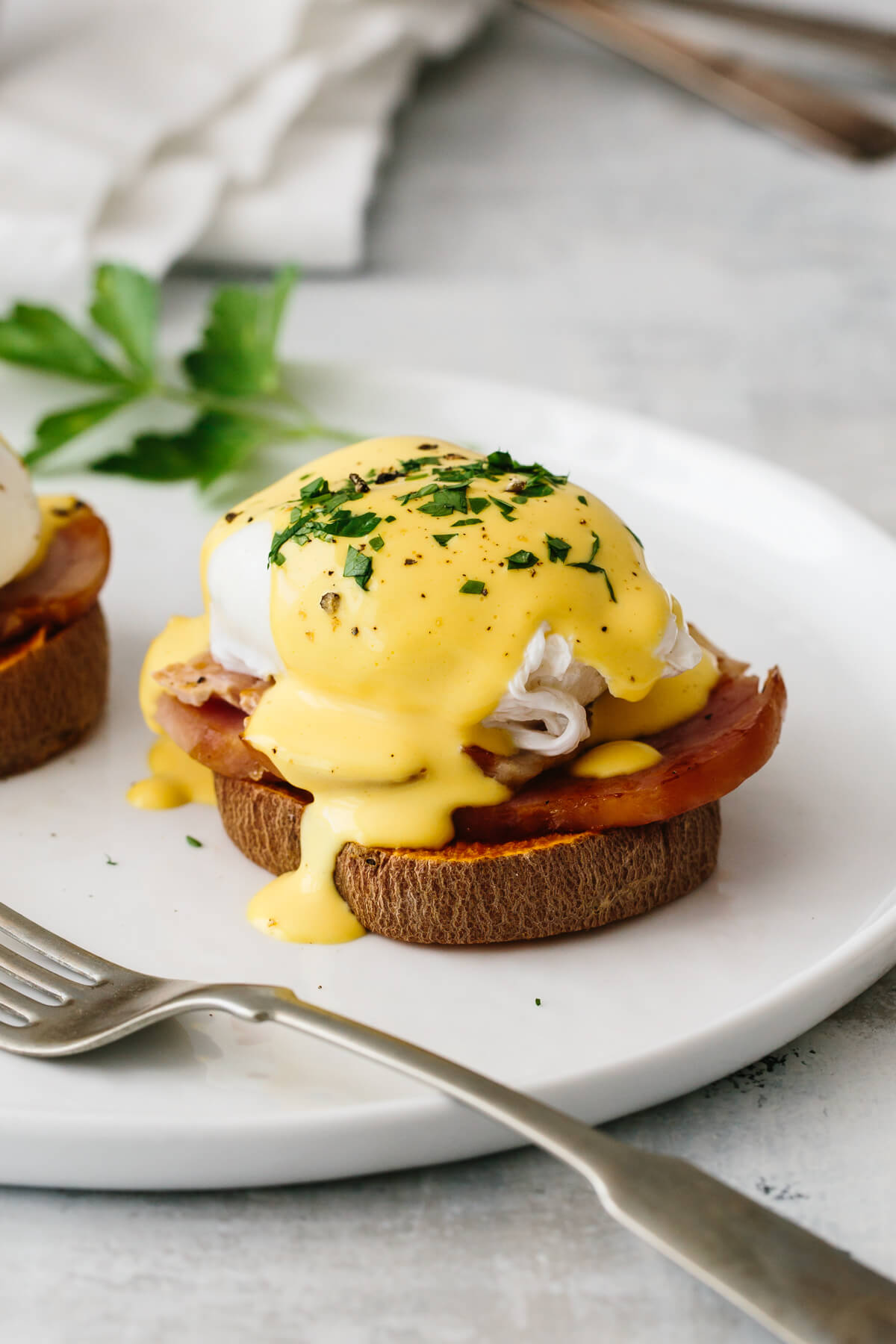Healthy eggs benedict on a plate.