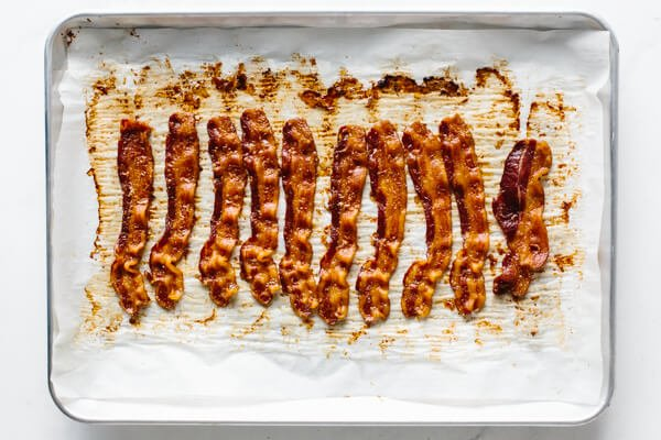 Cooked bacon on a baking tray.