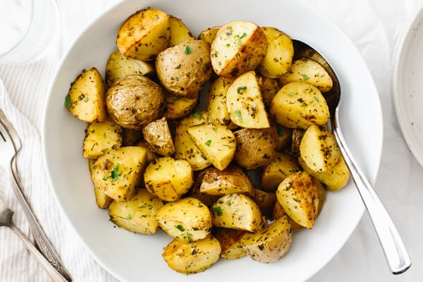 The roasted garlic herb potatoes in a serving bowl.