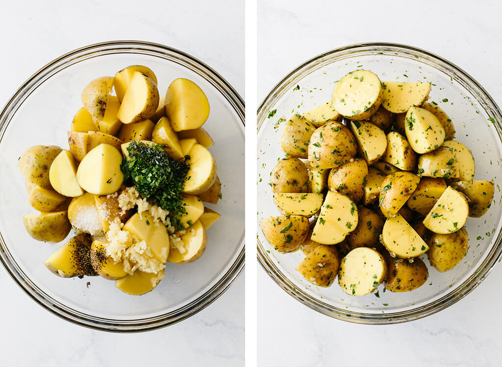 Mixing ingredients for garlic herb roasted potatoes in a mixing bowl.