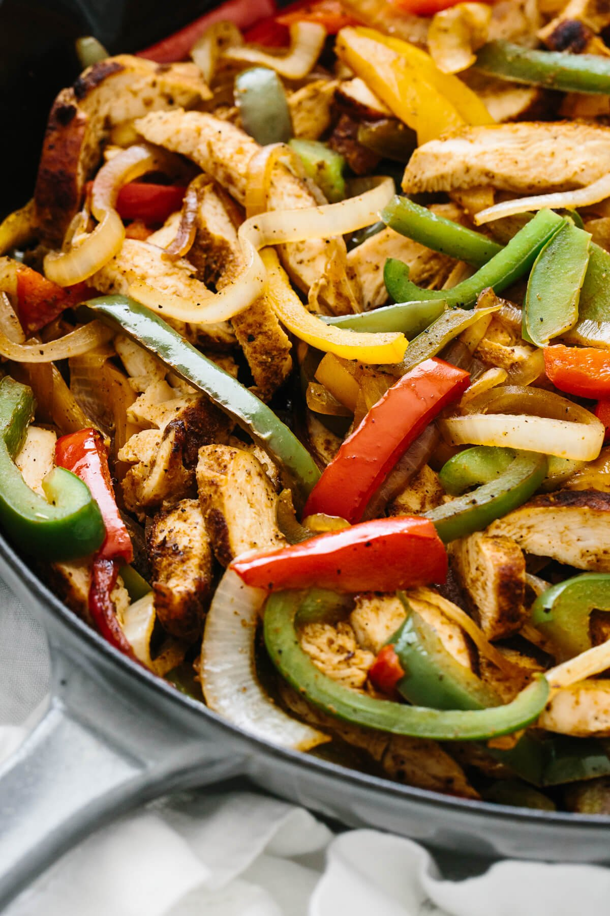 Chicken fajitas in a saute pan.