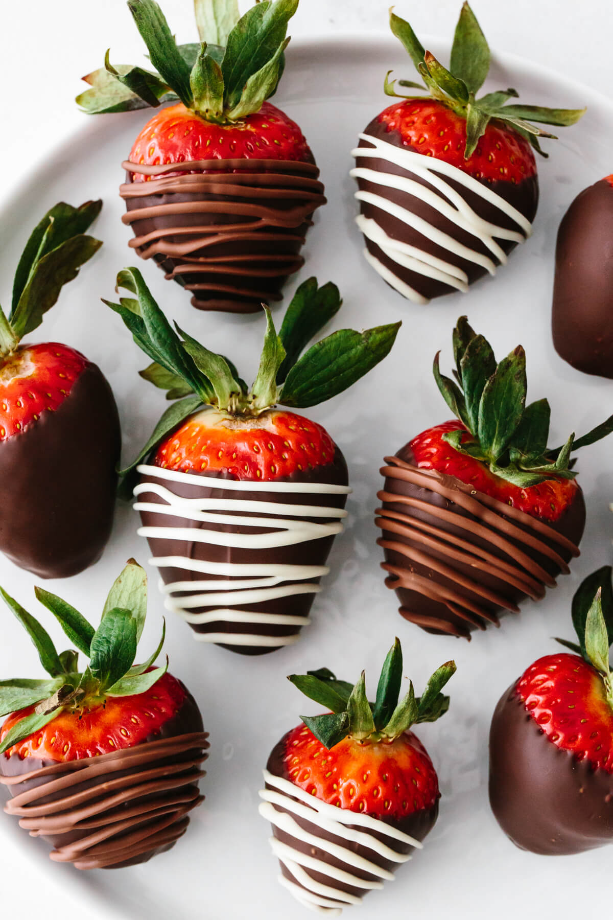Chocolate covered strawberry drizzled in white and milk chocolate.