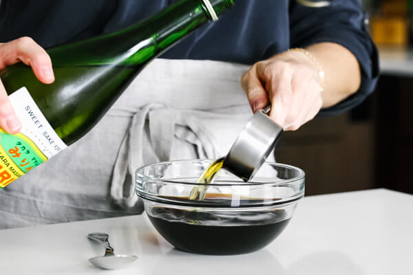 Making the teriyaki sauce in a bowl.