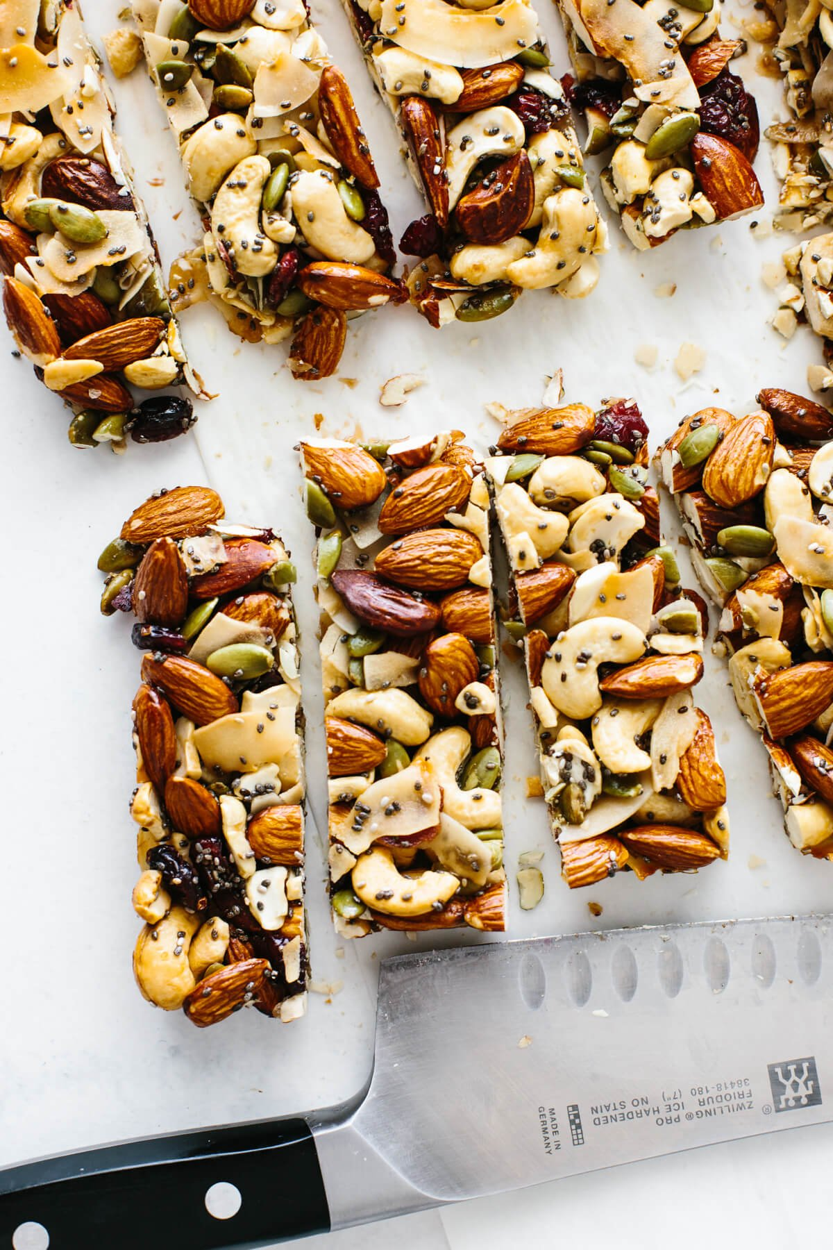 Trail mix bars cut into individual bars next to a knife.