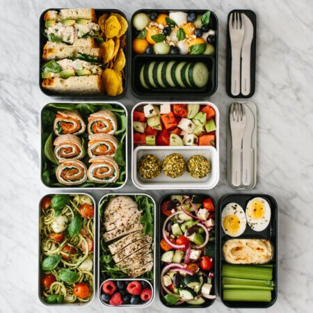 Bento box lunches lined up together on a table