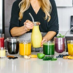Several anti-inflammatory drinks next to each other on a countertop.