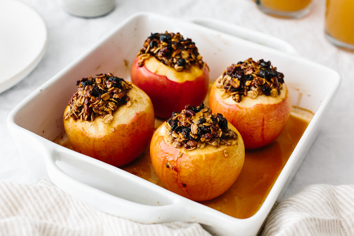 Baked apples in a baking dish fresh out of the oven.