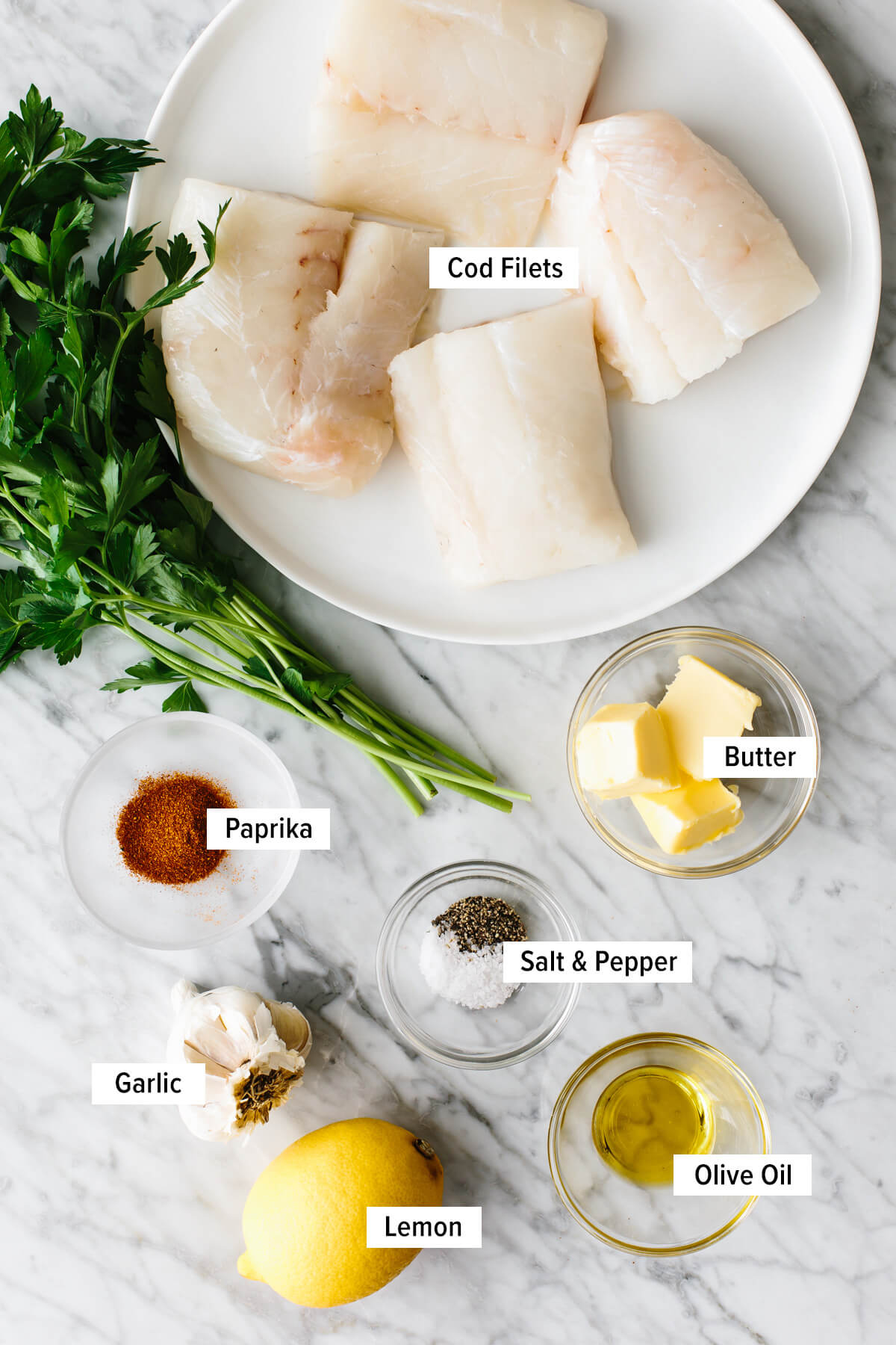 Ingredients for baked cod laid out on a table.