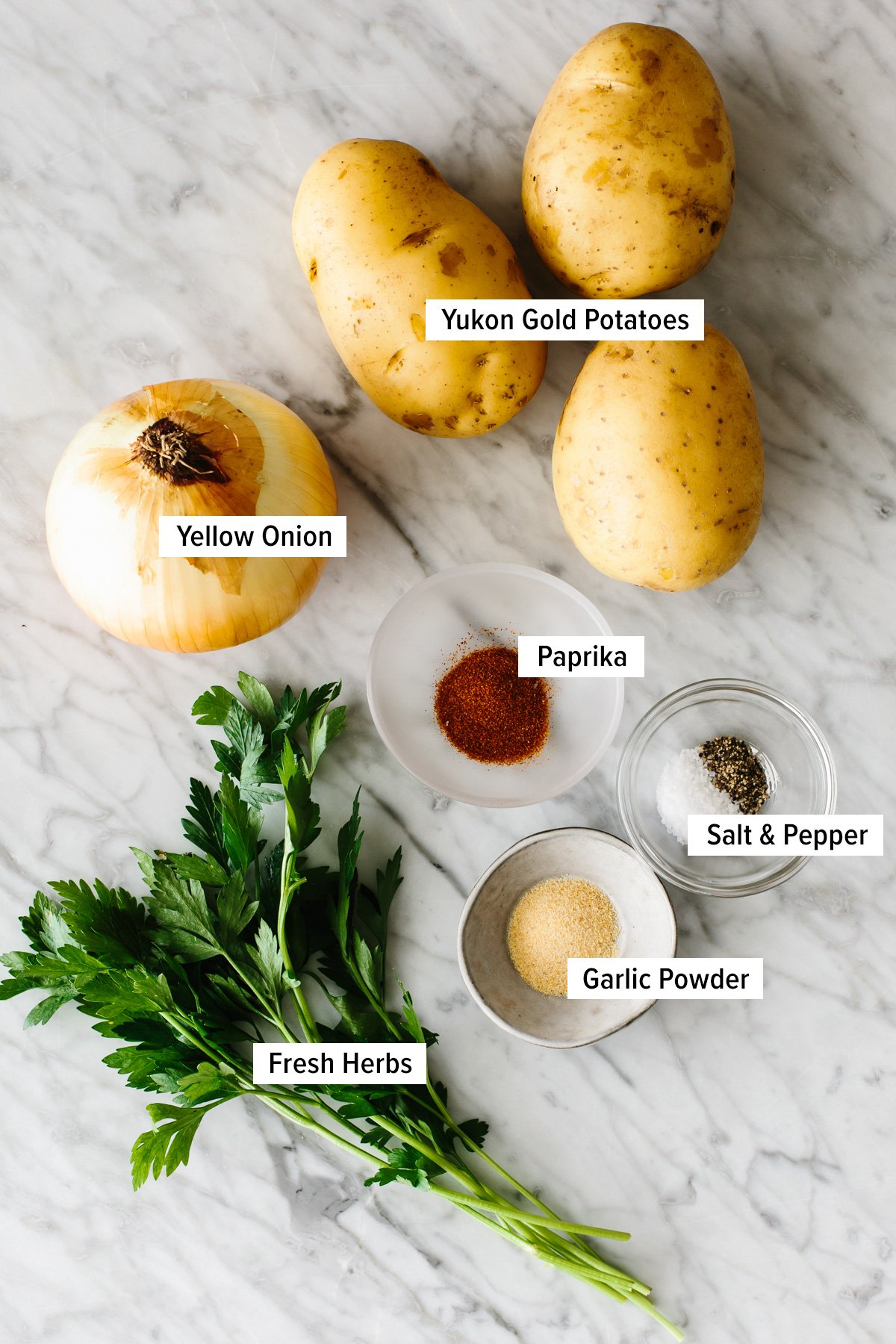 Ingredients for breakfast potatoes on a table.