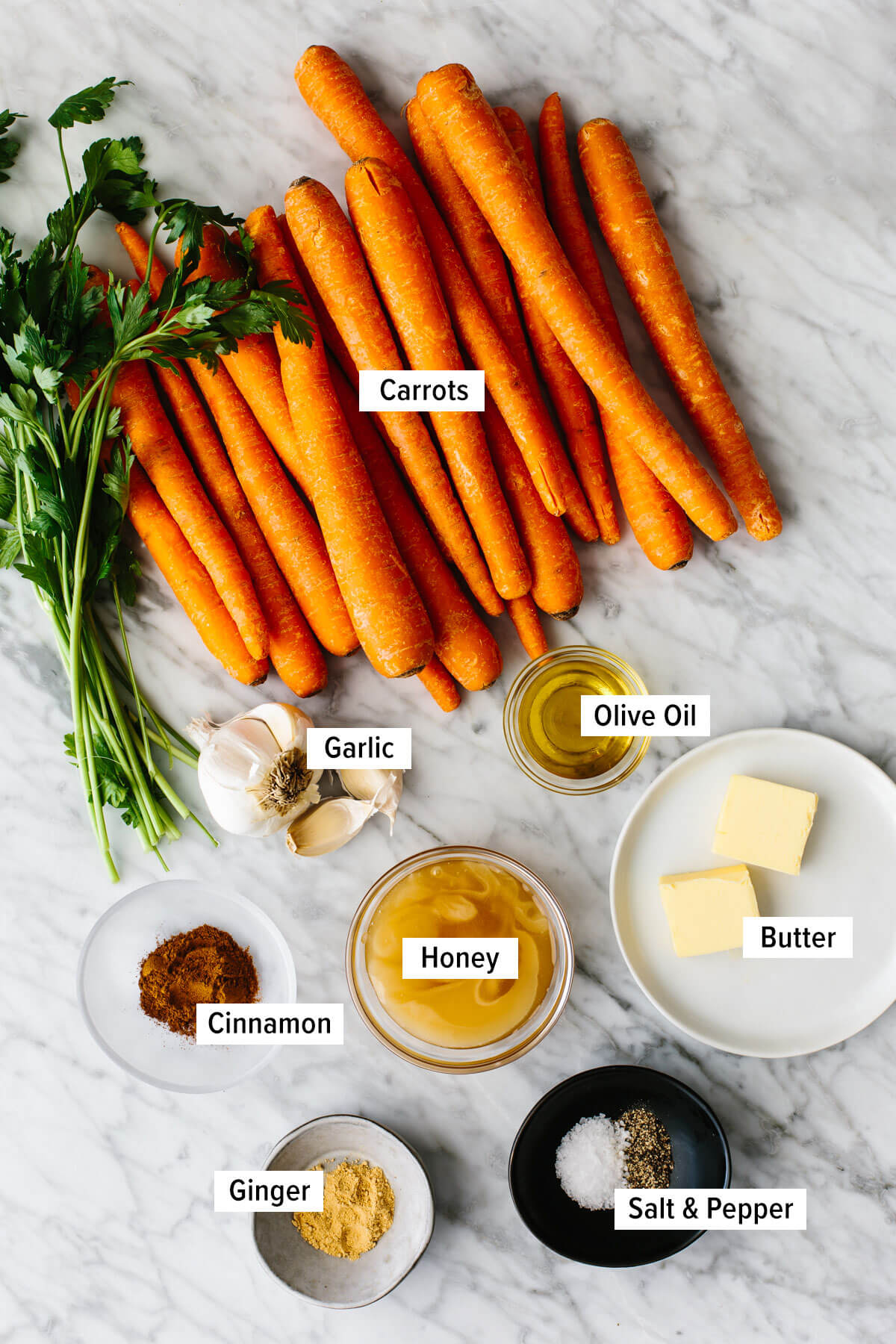 Ingredients for honey glazed carrots on a table.