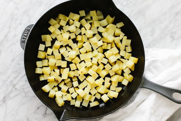 Diced potatoes in a skillet.