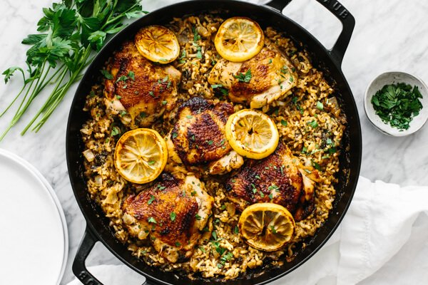 The finished chicken and rice recipe in one pan with garnishes.