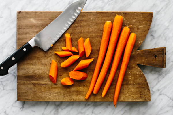 Carrots being chopped for honey glazed carrots.
