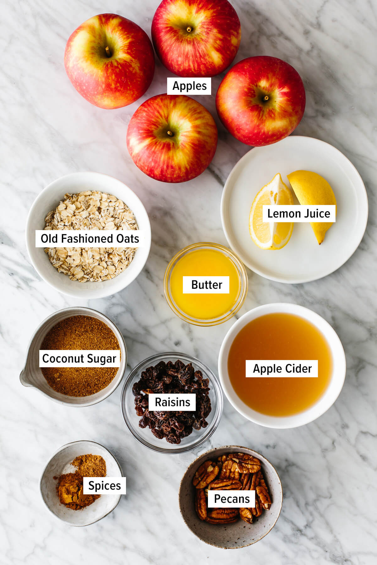 Ingredients for baked apples on a table.