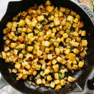 Crispy breakfast potatoes in a skillet.