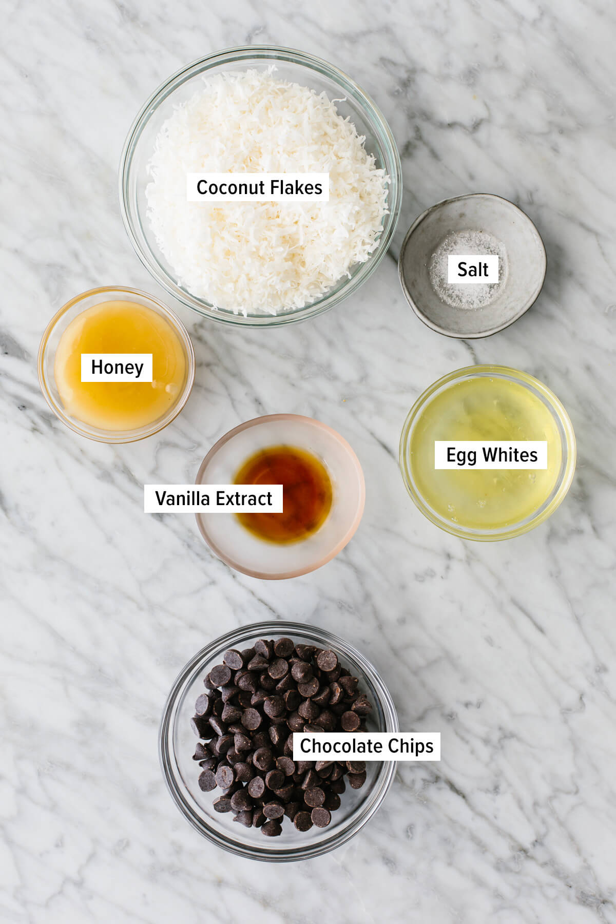 Ingredients for coconut macaroons on a table.