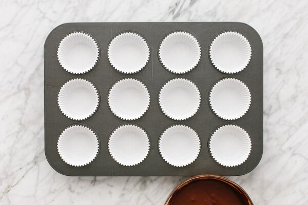 Muffin tin lined for almond butter cups