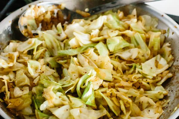 Fried cabbage in a pan on the stove.