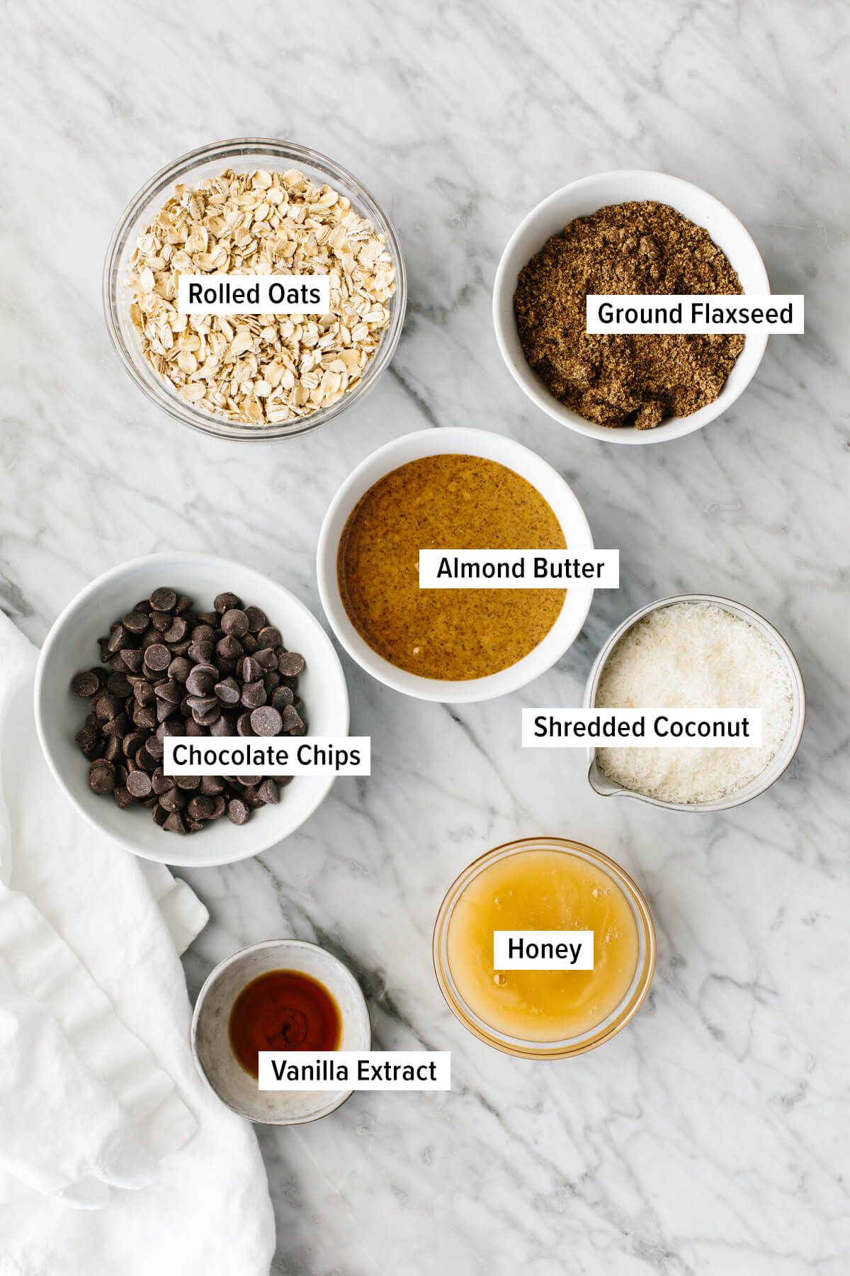 Ingredients for no bake chocolate chip energy balls on a table.