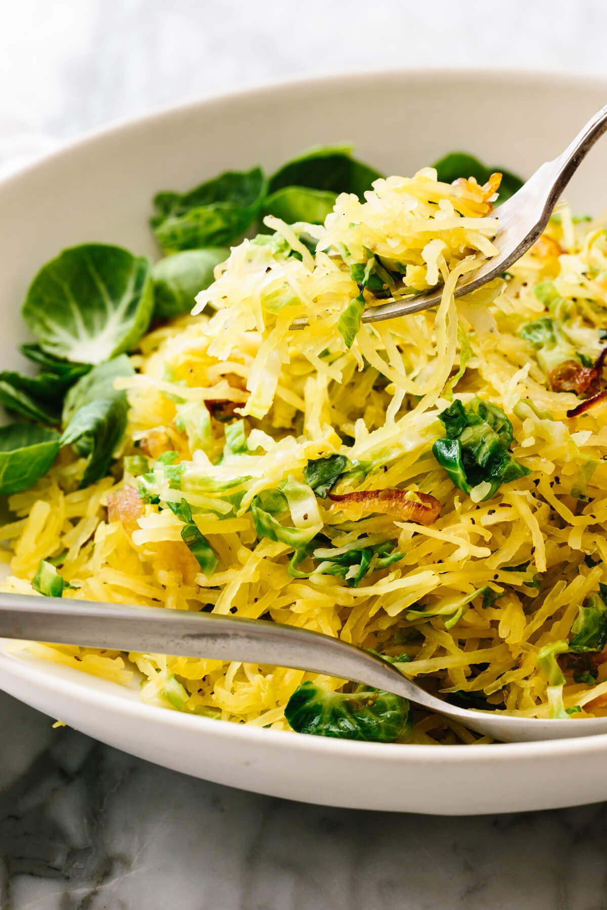 A bowl of spaghetti squash, Brussels sprouts, and crispy shallots