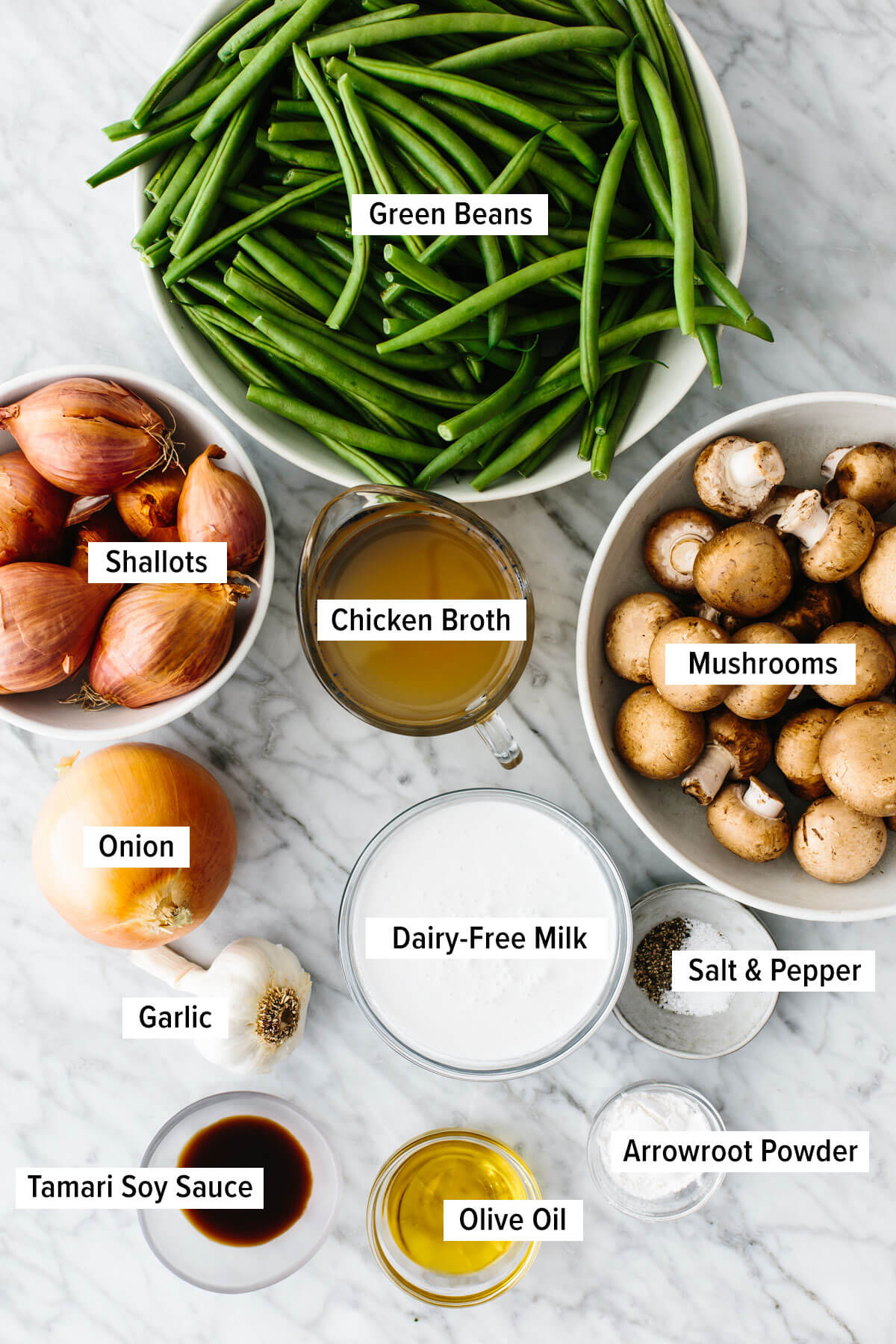Ingredients for a healthy green bean casserole on a table.