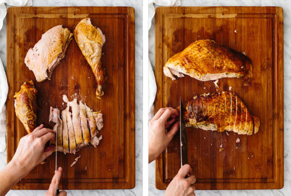 Carving a roasted turkey into small pieces.