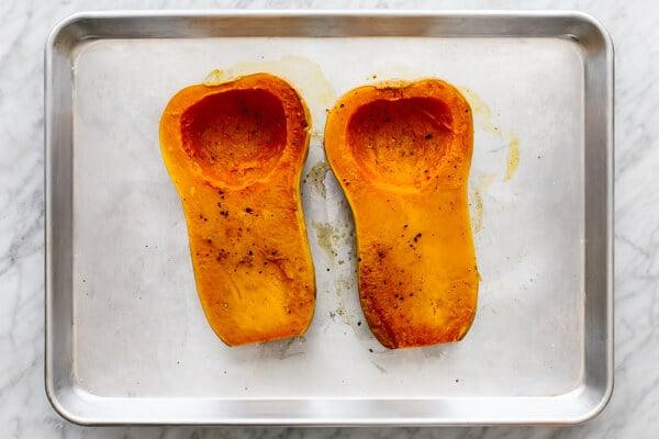Roasted butternut squash halves for orange shakshuka.