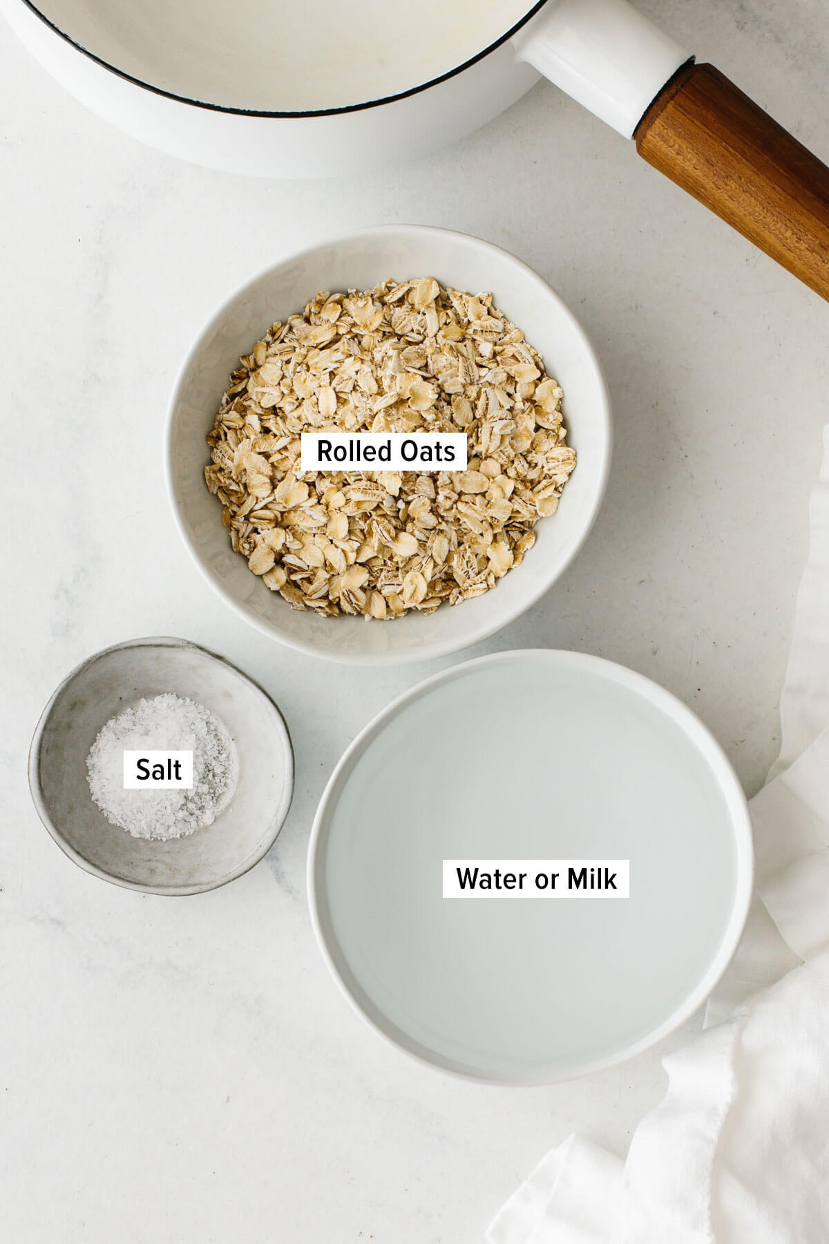Ingredients for oatmeal laying on a table