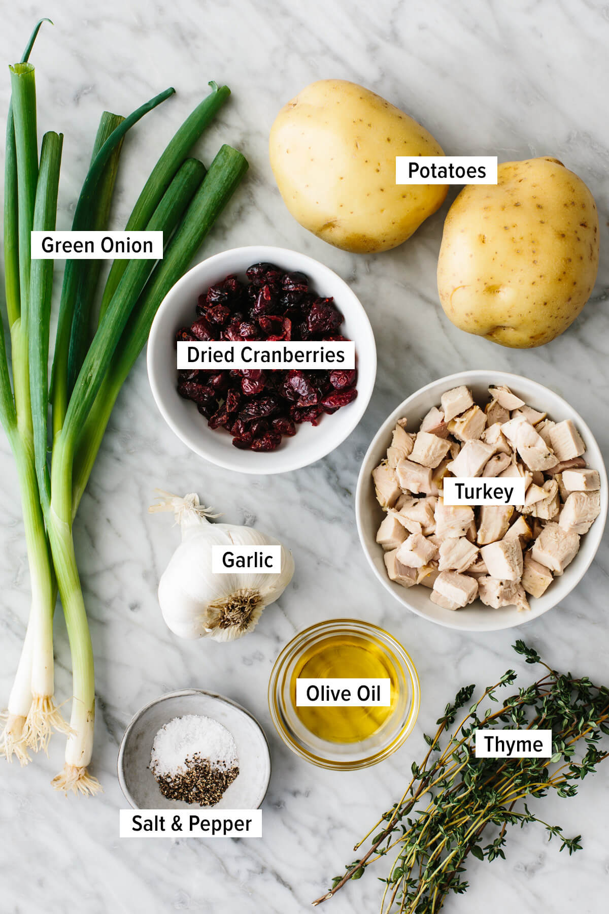Ingredients to make turkey cranberry hash on a table.