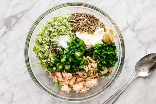 Ingredients for broccoli tuna salad in a bowl.