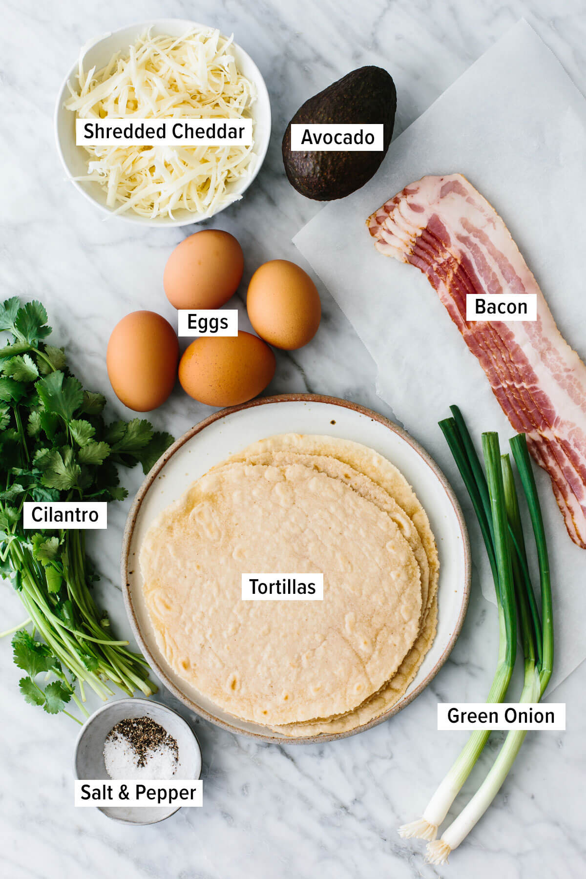 Ingredients for breakfast tacos on a table.