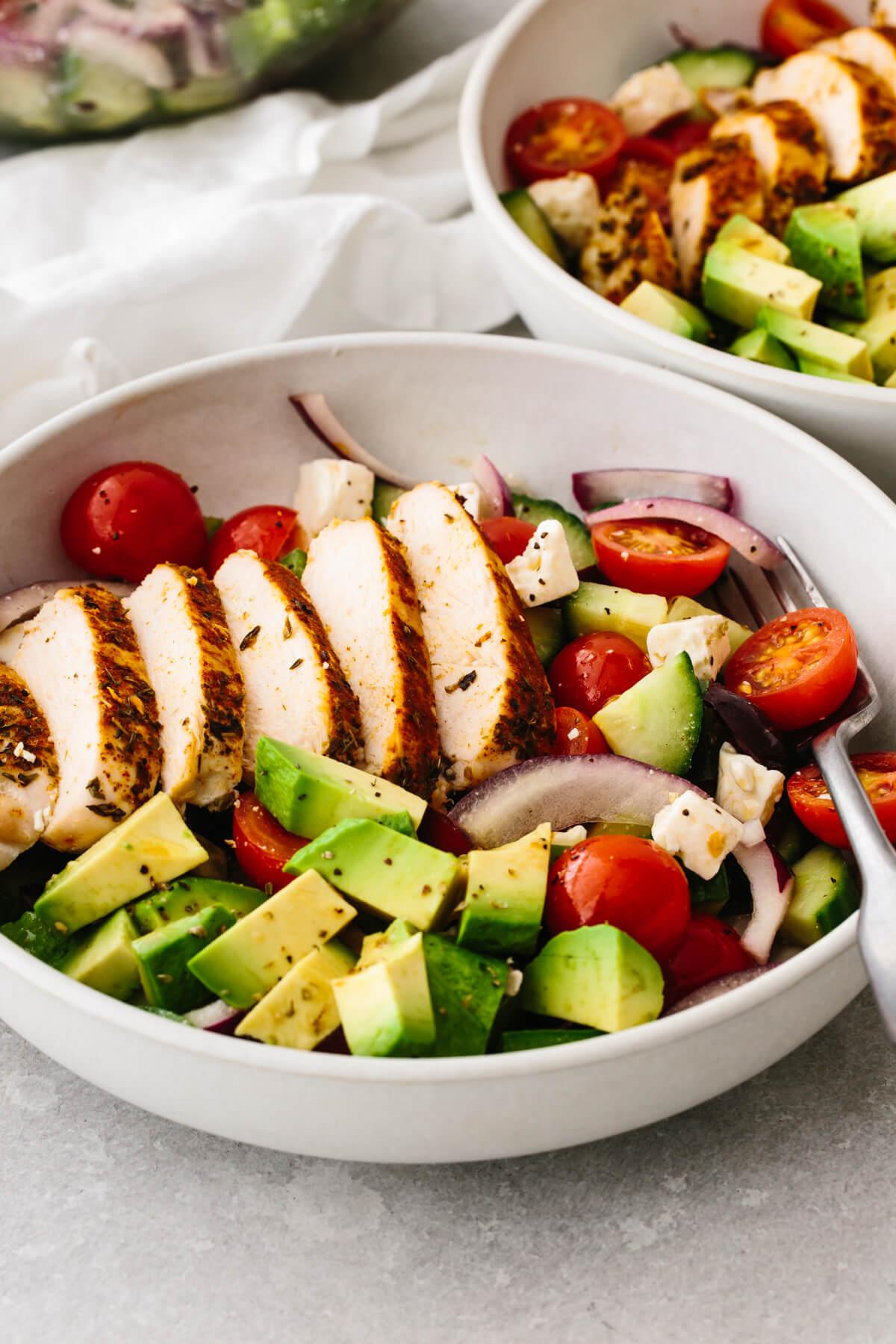 Greek chicken salad in a bowl.