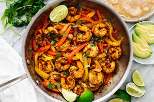 Shrimp fajitas in a large pan.