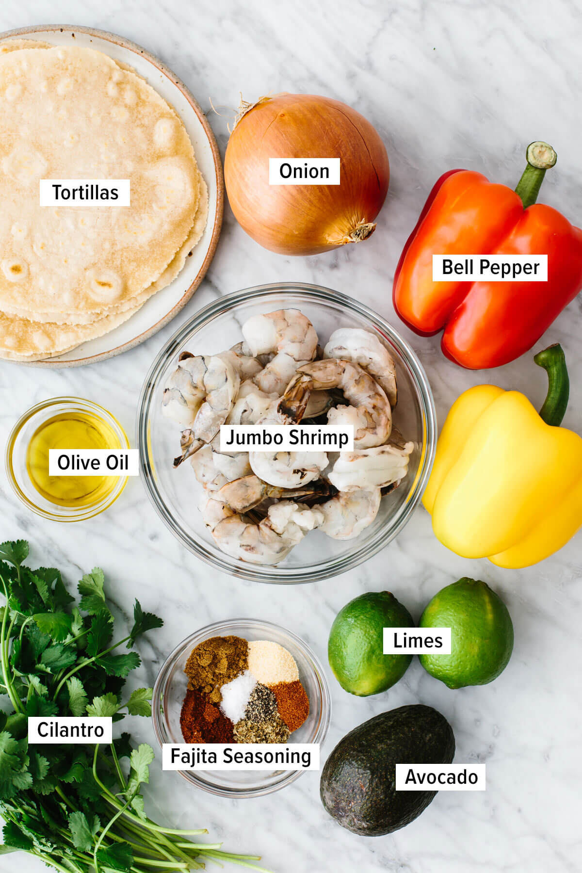 Ingredients for shrimp fajitas on a table.