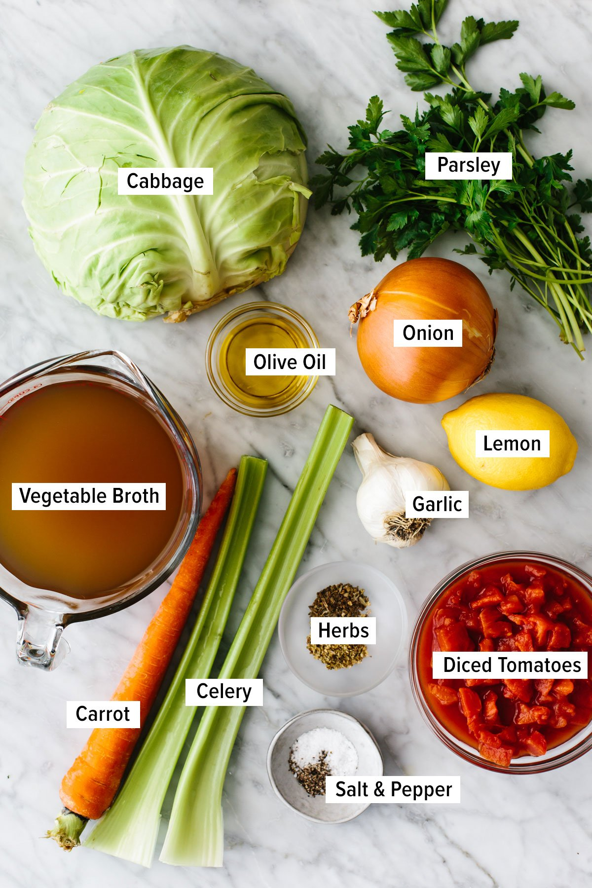 Ingredients for cabbage soup on a table.