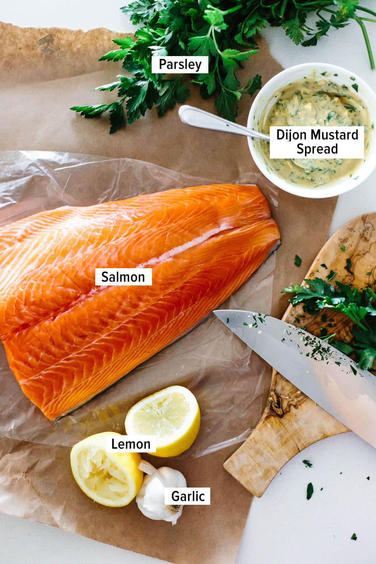 Ingredients to make Dijon baked salmon on a table.