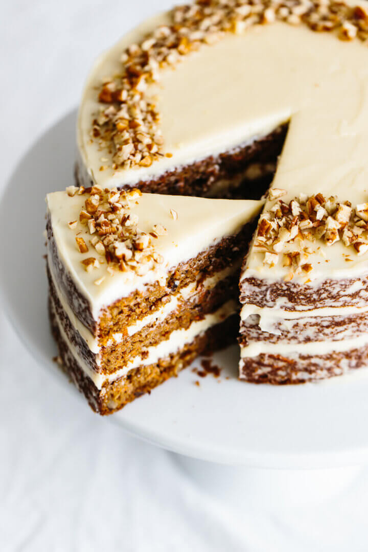 Gluten-free carrot cake on a cake stand.