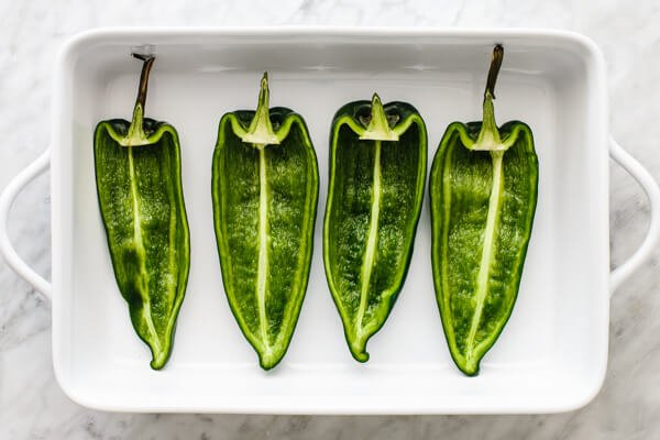 Roasted poblano peppers for carnitas stuffed poblano peppers.