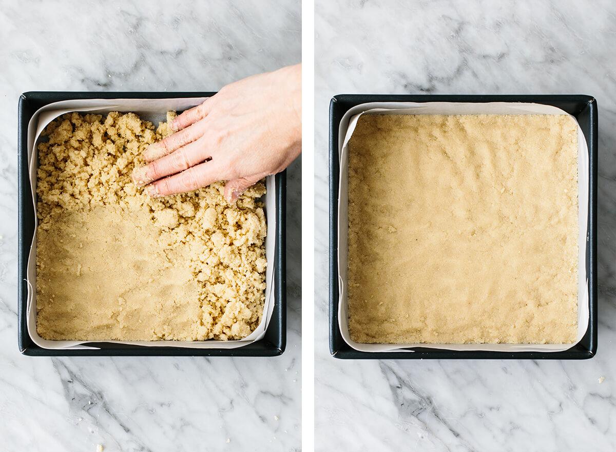 Pressing lemon bar crust into a pan.