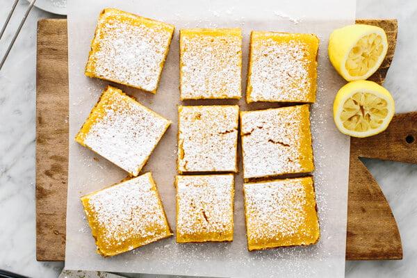Lemon bar slices on a board.