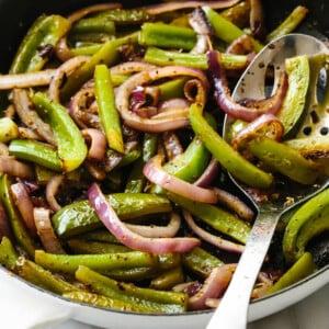 Sauteeing fajita veggies in a skillet.