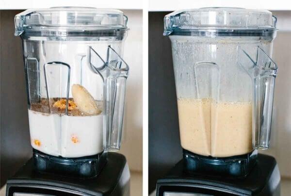 A blender blending a mandarin breakfast smoothie