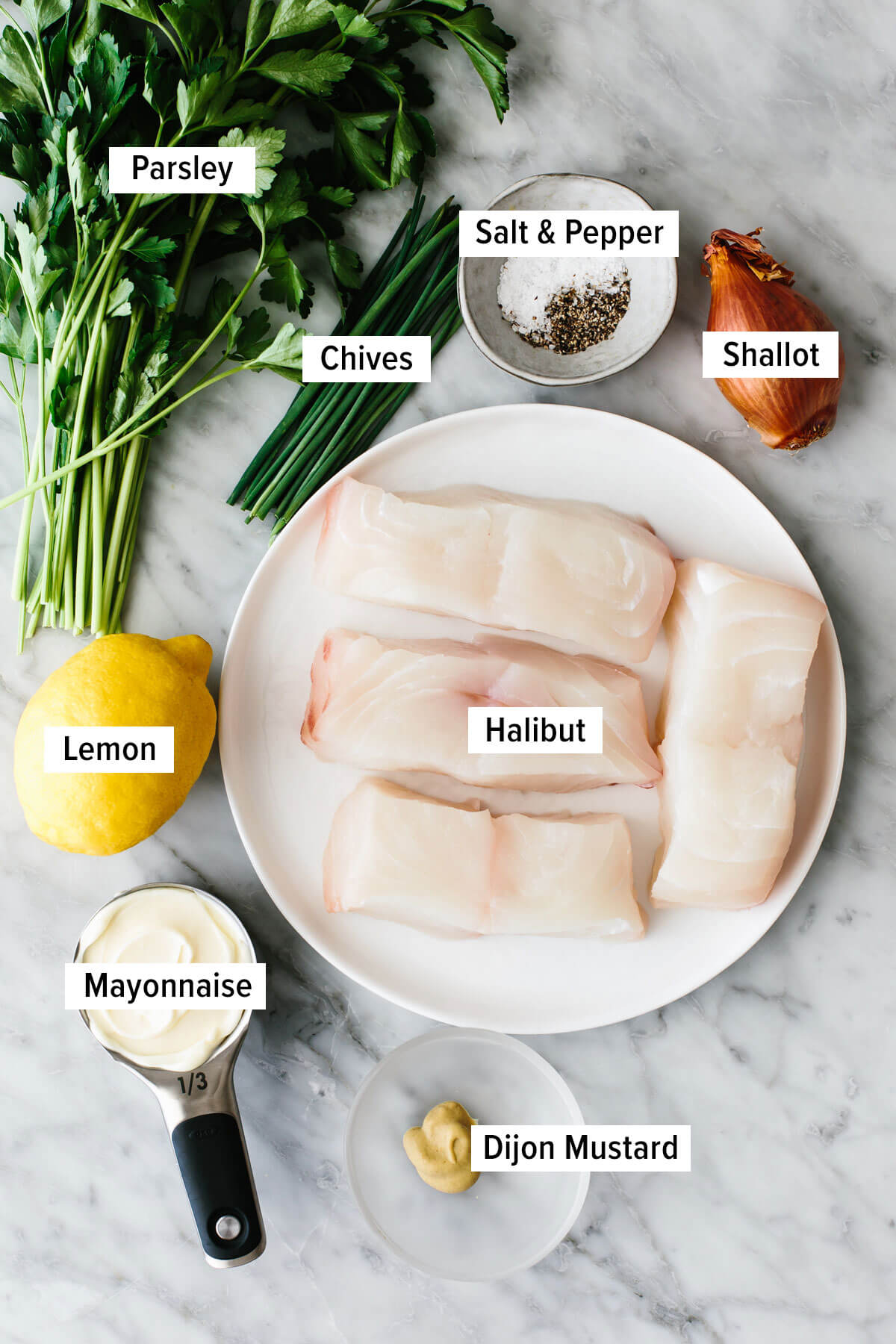 Ingredients for baked halibut on a table