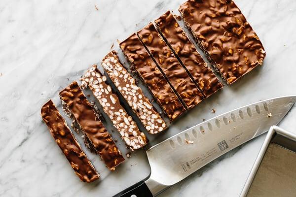 Sliced chocolate crunch bars on a table.