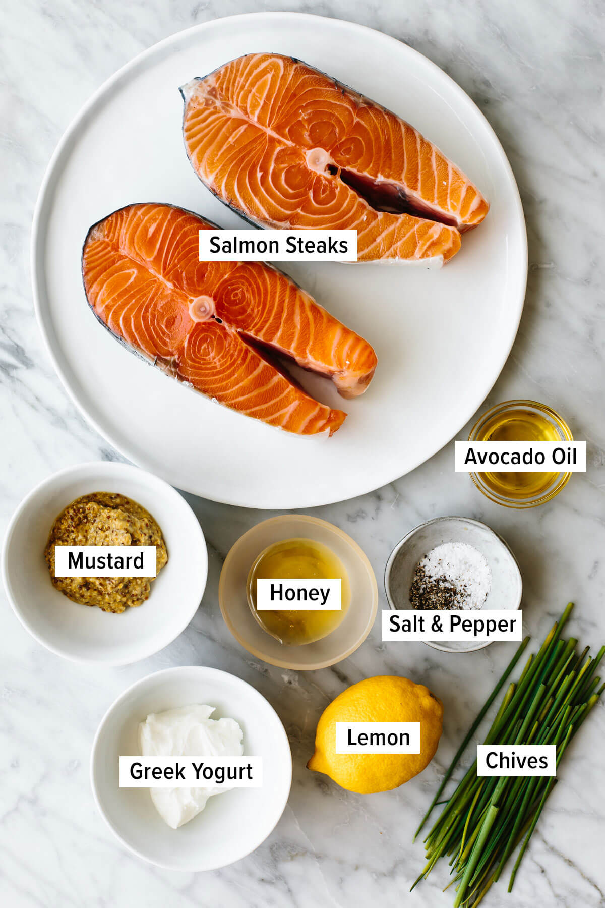Ingredients for grilled salmon steak on a table.